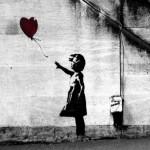 El niño y el globo negro